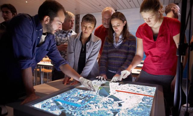 Stock photo of people looking at a map