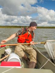 Field technician doing aquatic observational sampling