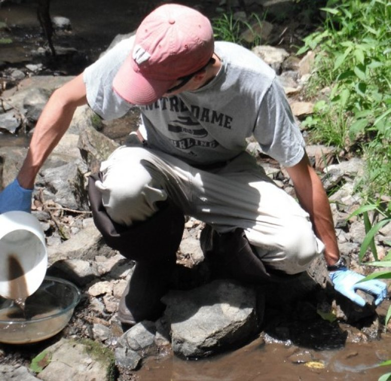 Sampling stream sediments using the hand scoop